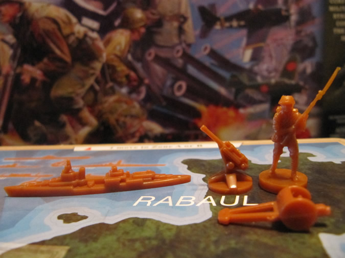 Axis & Allies Guadalcanal: Land units and cruiser.